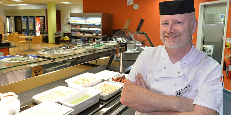 Chef Smiling with Food at Portal Sherwood Park Office Building, Nottingham